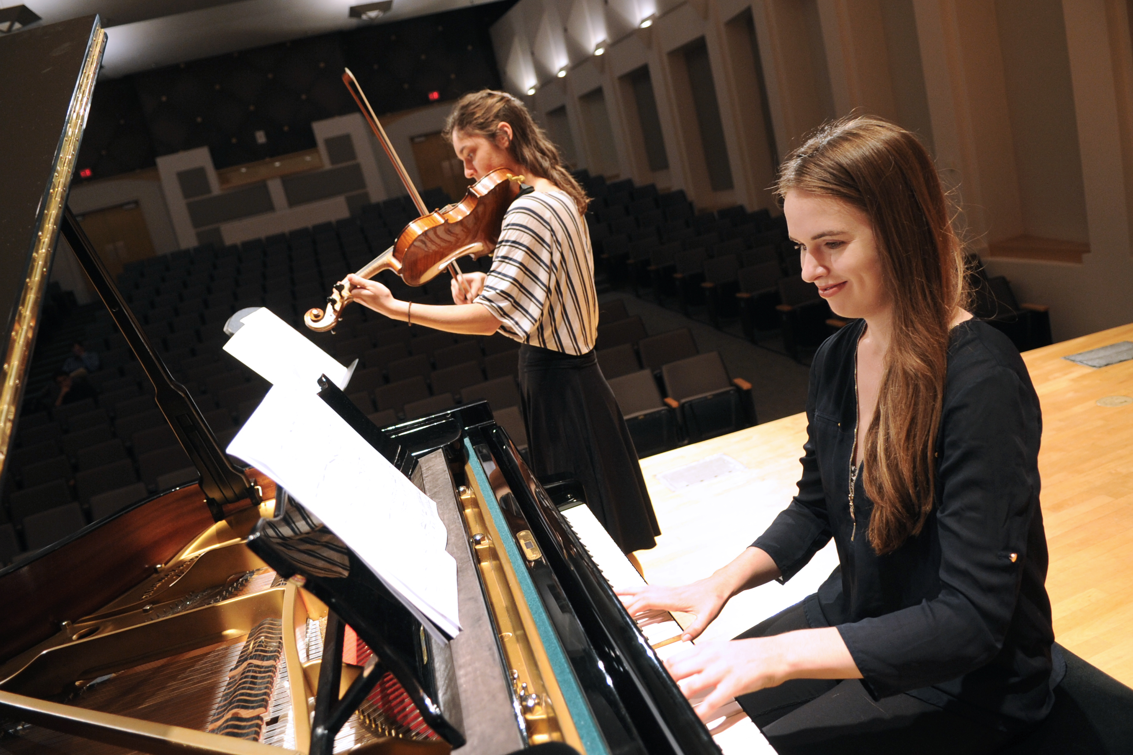duo performs piano and violin onstage