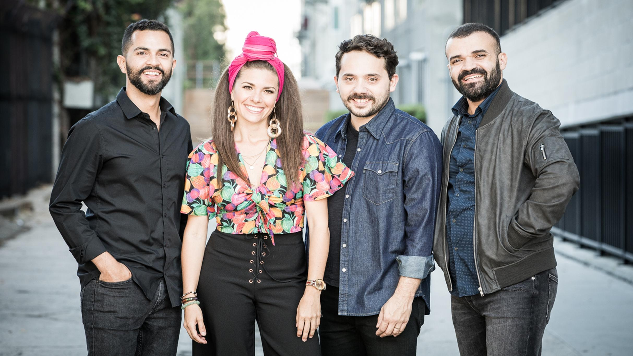 Caro and band posed for photo.