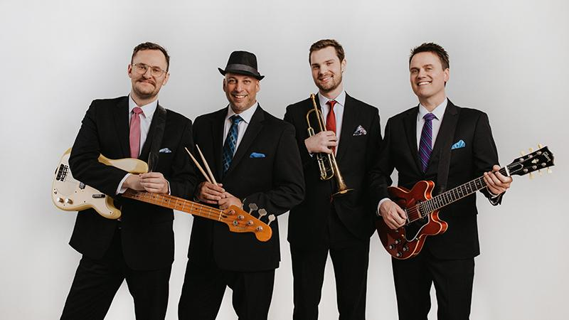The Four Freshmen pose in suits with guitar, drumsticks, trumpet and bass
