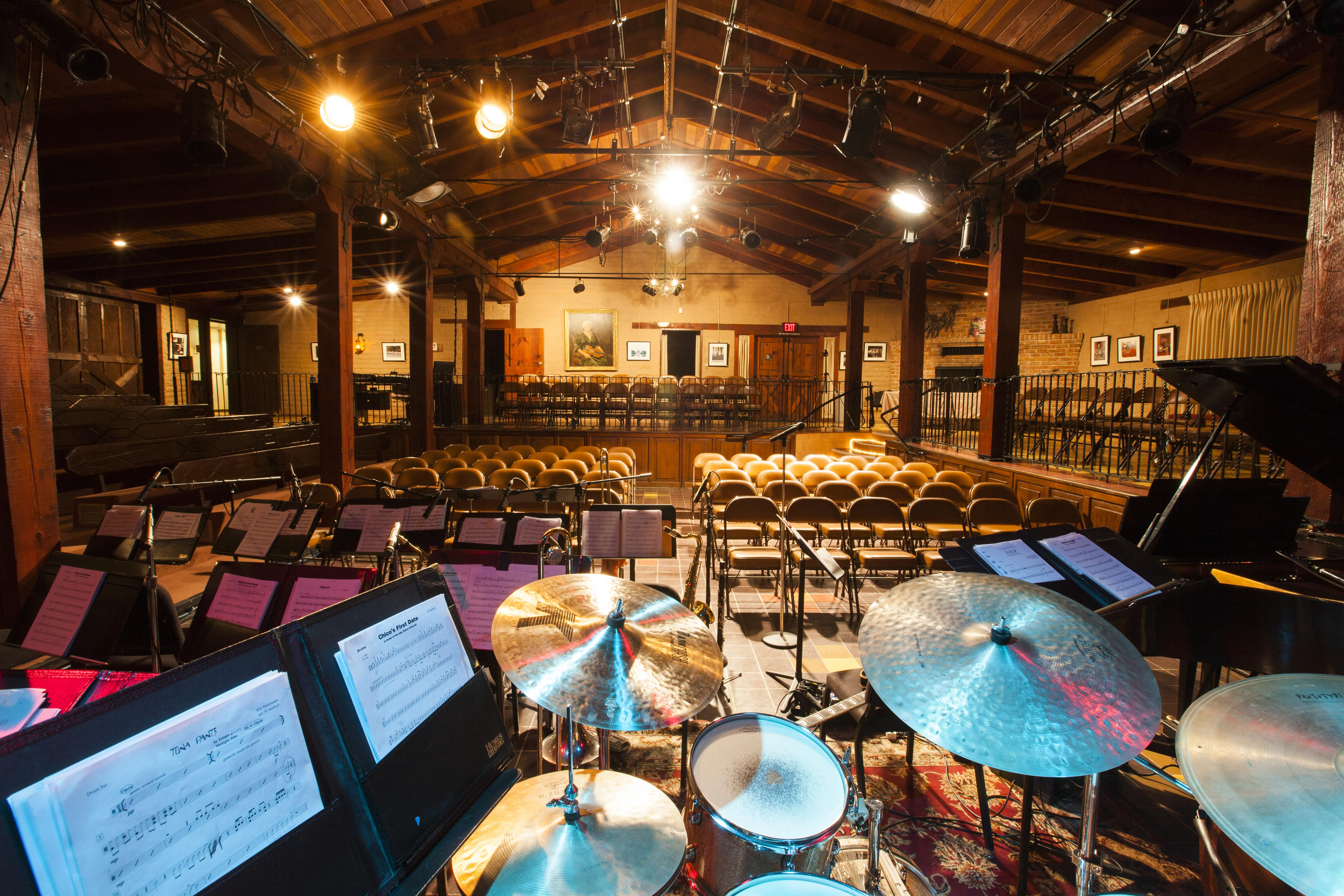 ASU Kerr venue interior from behind a drum kit in the stage area, showing empty seats