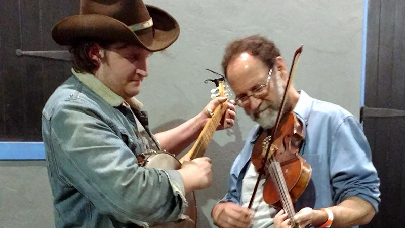 Willi Carlisle plays banjo with Ken Waldman on fiddle